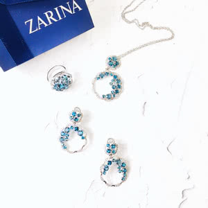 Jewelry set of white gold with topaz «Gloria»