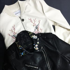 A bomber of a white color with a print (eco-leather)